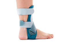 Man Wearing Ankle Support Brace in White Studio Royalty Free Stock Photos