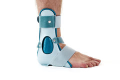 Man Wearing Ankle Support Cast in White Studio Stock Images