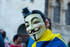 Man wearing an Anonymous mask protesting  Royalty Free Stock Images