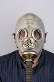 Man wearing antique gas mask Royalty Free Stock Photography