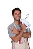 Man wearing apron Stock Images