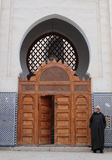 Man wearing arab djellaba next to Mosque entrance Royalty Free Stock Images