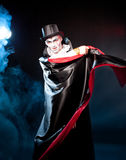 Man  wearing  as  vampire . Halloween. Young man   wearing  as  vampire . Halloween Stock Photography