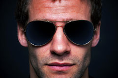 Man wearing aviator sunglasses Stock Photography