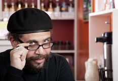 Man wearing beret in coffee house Stock Image