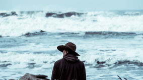 Man Wearing Black Cowboy Hat Standing in Front of Sea Stock Photos