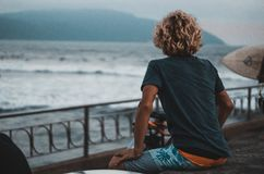 Man Wearing Black Crew-neck T-shirt and Blue Board Shorts Royalty Free Stock Images