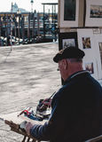 Man Wearing Black Hat and Black Sweater Painting in Street Stock Photos