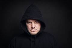Man wearing black hoodie. Hooligan or gangster concept Royalty Free Stock Image