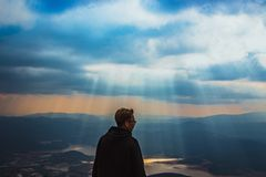 Man Wearing Black Jacket Above The Mountain Stock Photography