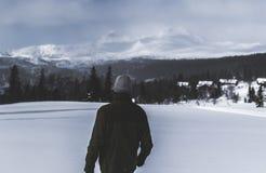 Man Wearing Black Jacket Walking in the Snow Stock Photos