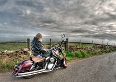 Man Wearing Black Leather Jacket Riding Cruiser Motorcycle on Road Royalty Free Stock Photo