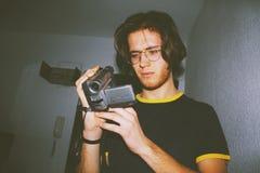 Man Wearing Black Shirt Holding Digital Camcorder stock images