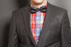 Man wearing a black suit and black bow tie Royalty Free Stock Photography