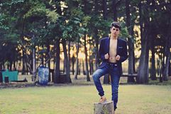 Man Wearing Black Suit Jacket and Blue Denim Jeans during Daytime Royalty Free Stock Images