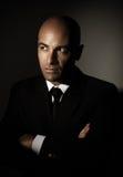 Man wearing black suit Stock Images