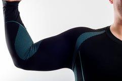 Man wearing black thermal base layer underwear. On white background stock photos