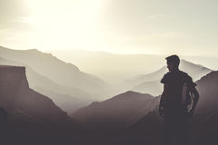 Man Wearing Black Tops at the Top of the Mountain Stock Photo