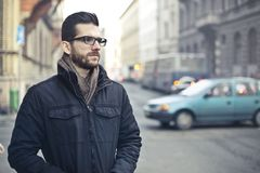 Man Wearing Black Zip-up Jacket Standing on the Street Stock Photos