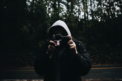 Man Wearing Black Zipped Up Hoodie Stock Images