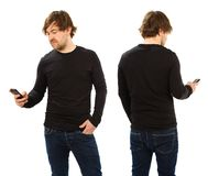 Man wearing blank black shirt holding phone Royalty Free Stock Photography