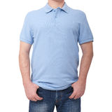Man wearing blank blue t-shirt isolated on white background with copy space. Tshirt design and people concept - close up. Of men in blank shirt. For mock up royalty free stock image