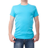 Man wearing blank blue t-shirt isolated on white background with copy space. Tshirt design and people concept - close up royalty free stock image