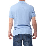 Man wearing blank blue t-shirt isolated on white background with copy space. Tshirt design and people concept - close up. Of men in blank shirt. For mock up stock photos