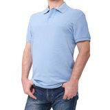 Man wearing blank blue t-shirt isolated on white background with copy space. Tshirt design and people concept - close up. Of men in blank shirt. For mock up royalty free stock images