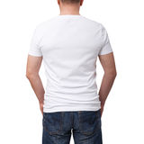 Man wearing blank t-shirt on gray brick wall background with copy space. Tshirt design and people concept - close up of. Man in blank white t-shirt. For mock up royalty free stock image