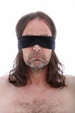 Man wearing a blindfold Royalty Free Stock Photos