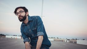 Man Wearing Blue Denim Buttons Up Long Sleeve and Blace Frame Eyelgasses Stock Photography