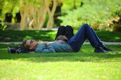 Man Wearing Blue Long Sleeve Shirt Lying on Ground during Daytime Stock Photography