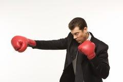 Man wearing boxing gloves stock photo