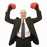 Man wearing boxing gloves Stock Image