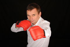 Man wearing boxing gloves Royalty Free Stock Photo