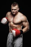 Man wearing boxing gloves Stock Photography