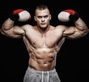 Man wearing boxing gloves Royalty Free Stock Photos