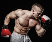 Man wearing boxing gloves Stock Photos