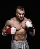 Man wearing boxing gloves Stock Image