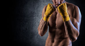 Man wearing boxing gloves Royalty Free Stock Images