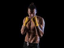 Man wearing boxing gloves Royalty Free Stock Image