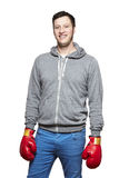 Man wearing boxing gloves smiling. On white background Royalty Free Stock Photos