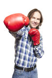 Man wearing boxing gloves smiling. On white background Royalty Free Stock Photography
