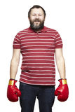 Man wearing boxing gloves smiling. On white background Royalty Free Stock Image