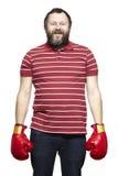 Man wearing boxing gloves smiling Royalty Free Stock Image