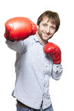 Man wearing boxing gloves smiling Stock Photo