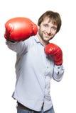 Man wearing boxing gloves smiling Stock Photo