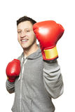 Man wearing boxing gloves smiling. On white background Royalty Free Stock Images
