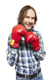 Man wearing boxing gloves smiling. On white background Stock Image
